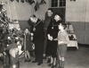 The Mayor and Mayoress of Aldershot, Councillor and Mrs Stroud, admire the Christmas tree with a couple of children at the No. 1 Canadian General Reinforcement Unit Christmas Party in 1943. Behind is RSM Jewkes of St Johns, Quebec. (Courtesy of the Aldershot Military Museum)